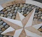 Rose of winds:travertine and pebbles.